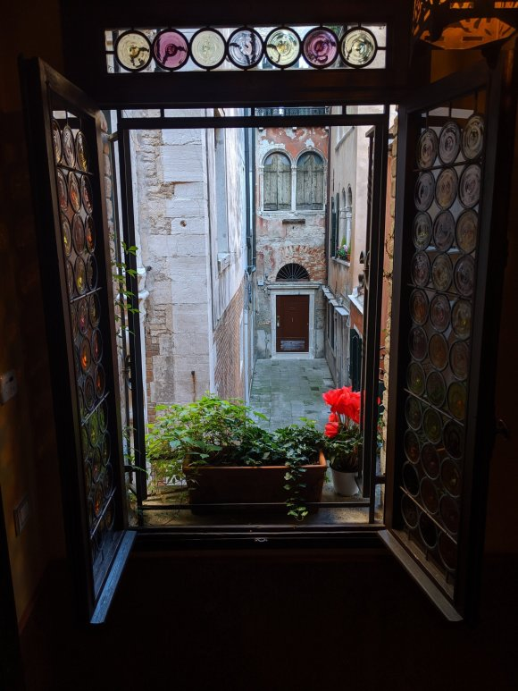 View out ornate window into alley