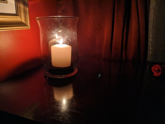 Candle in a hurricane vase