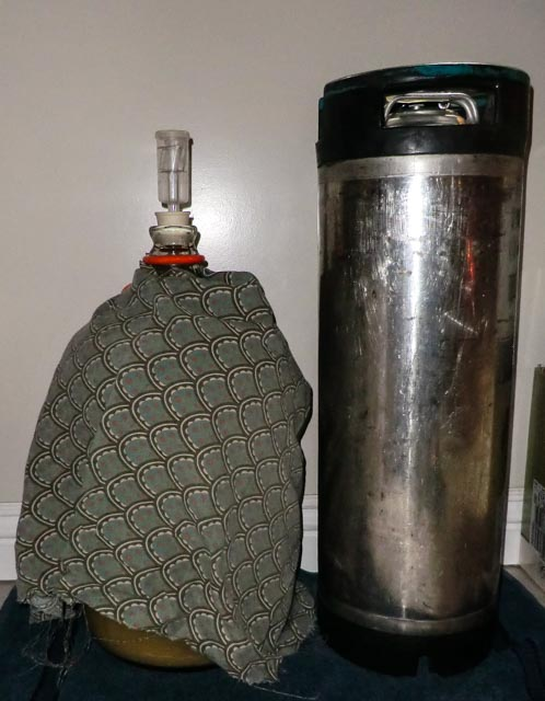 Cloth-covered fermentation carboy and stainless canister