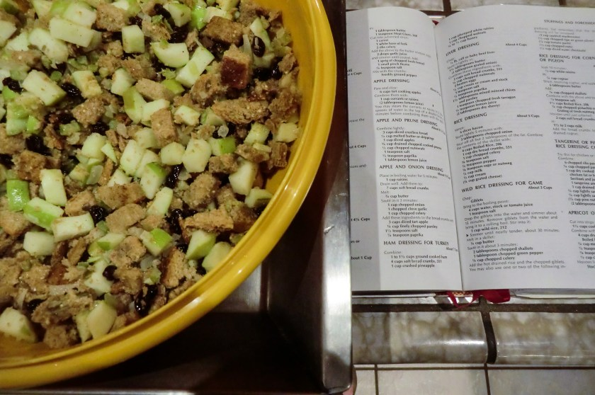 The Joy of Cooking opened to page 327 with a recipe and a bowl containing the completed stuffing.