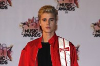Canadian singer Justin Bieber poses on the red carpet upon his arrival at the Palais des Festivals to attend the 17th Annual NRJ Music Awards in Cannes, southeastern France, on November 7, 2015. AFP PHOTO / VALERY HACHE