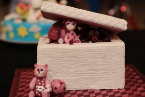 A small toy box filled with little animal toys.