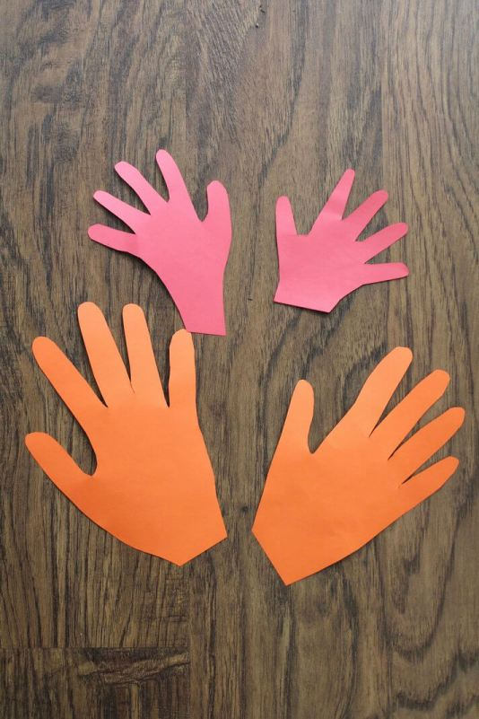 Red and orange hand cut-outs