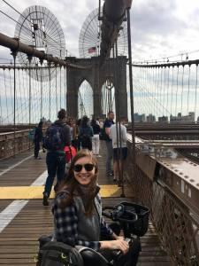 Alison Avery in scooter on Brooklyn Bridge