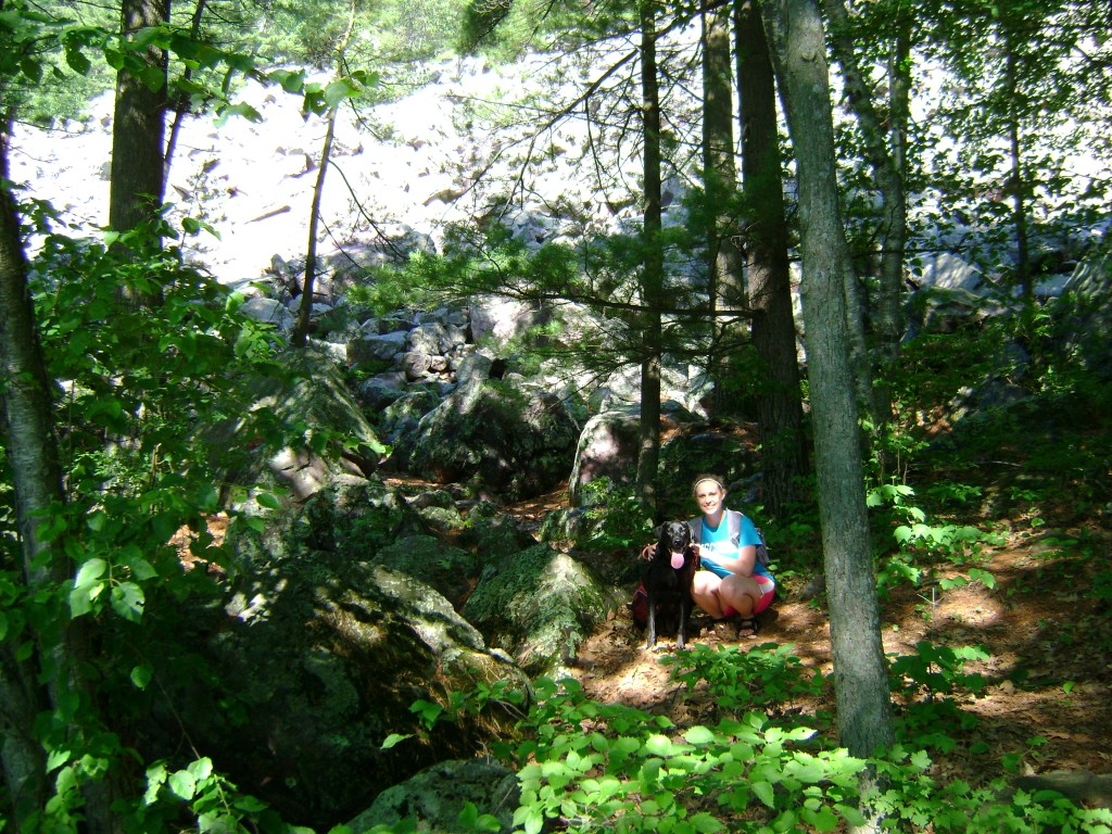 Laura and dog Bailey hiking at Devils Lake State Park in July 2009