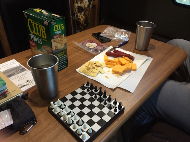 A game of chess over lunch inside the camper