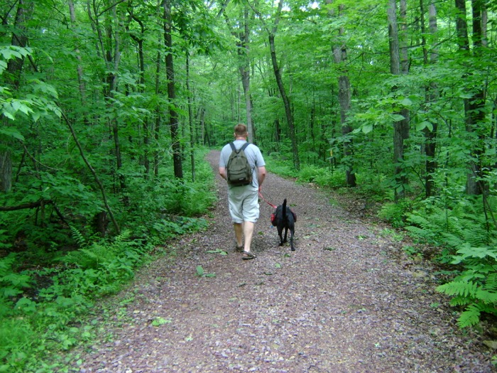 Jason hiking with Bailey in Devil's Lake State Park