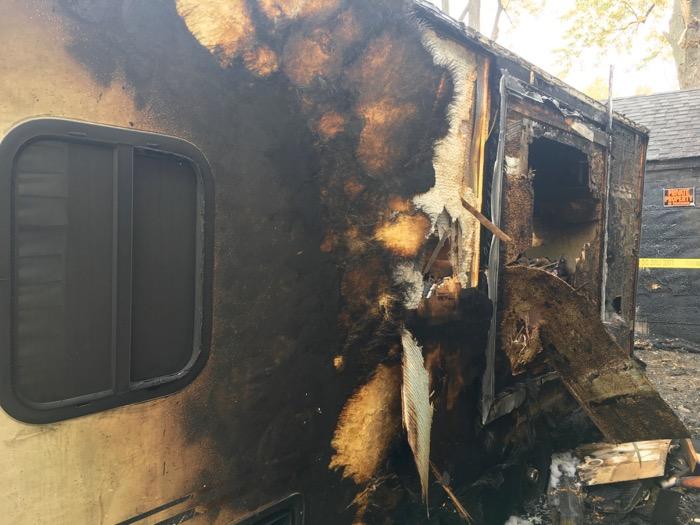 Side of fire-damaged camper