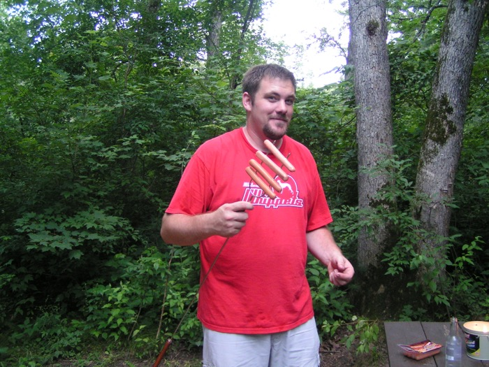Jason with hot dogs for our first camping trip dinner