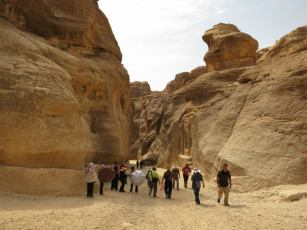 Walking through the Siq, main entrance to the ancient city of Petra.