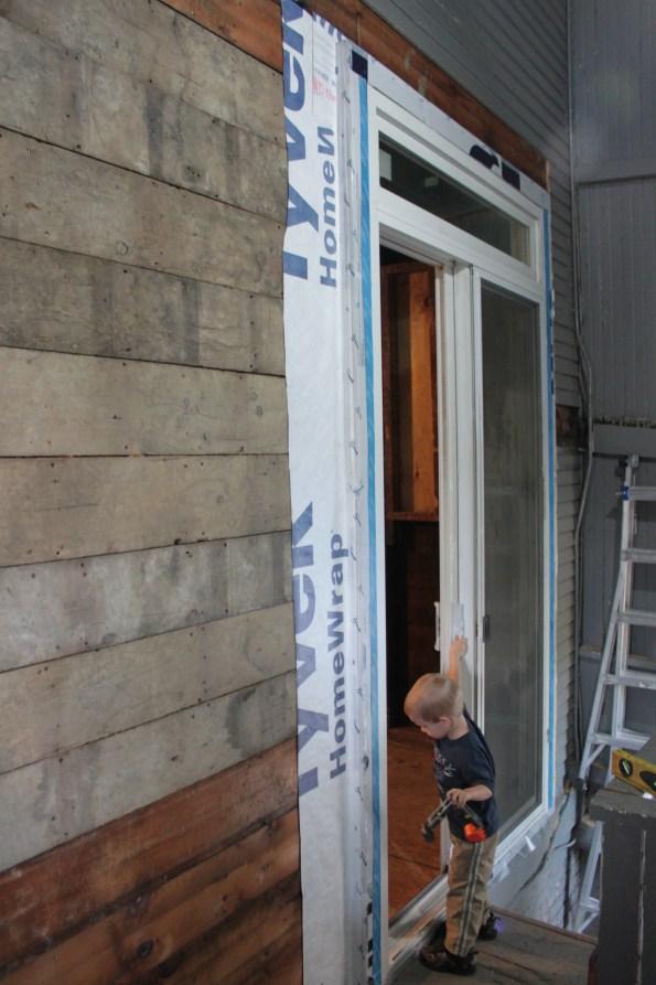 Derek tries out the new door
