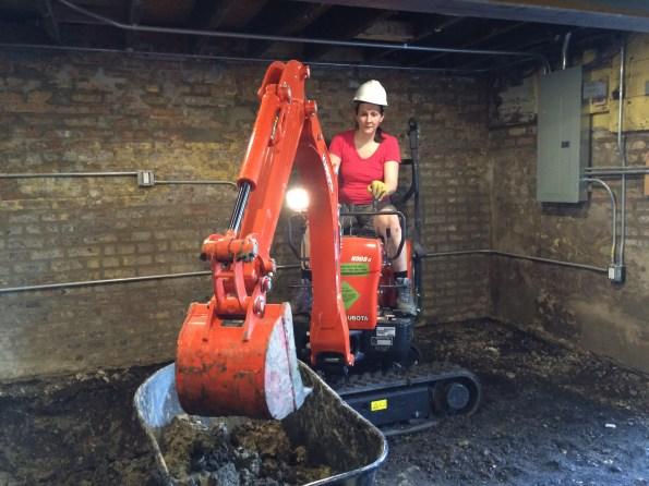 Sarah using the digger
