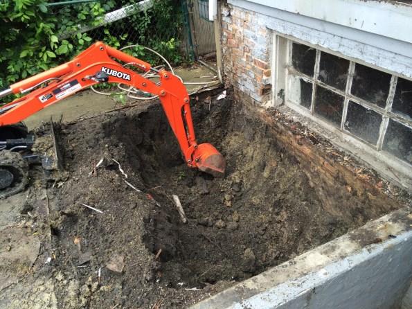 Digging for new back steps