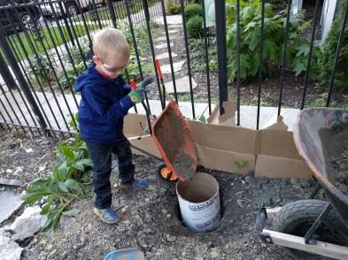 Derek pouring concrete