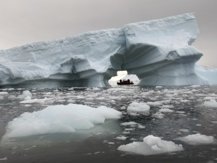 Another incredible arch formed into a massive iceberg. Unreal.