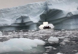 One more spectacular shot peering through an arched iceberg toward another Zodiac from our Antarctic expedition ship. Right place. Right time. Lucky shot! :) Such an amazing experience!