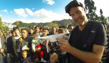 Flying the drone and attracting a crowd in Leishan, China.