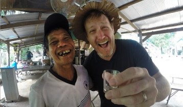 Smiles and shots of palm whiskey in Cambodia.