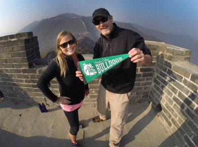 Rocking a Clarendon College pennant atop the Great Wall of China!