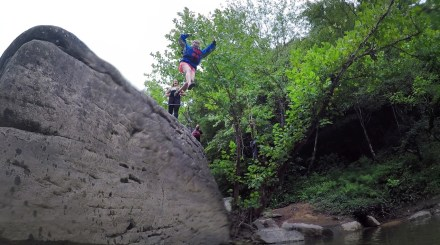 "Taking the leap off of ""Jump Rock"" along the Cumberland."