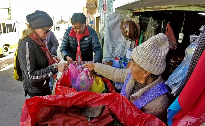 Buying dynamite - yes DYNAMITE - and a few other items at a market in Potosi.