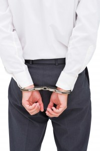 New Mexico fraud attorney - Business Man in Handcuffs