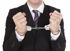 Santa Fe Embezzlement Attorney - Business Man in Handcuffs