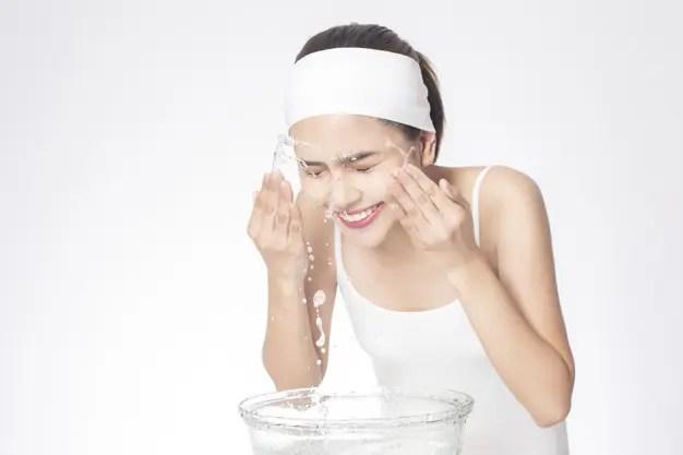 Beautiful woman is washing her face