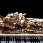 Famous Matzo Caramel Almond Crunch made with Matzo, butter, brown sugar, chocolate chips and almonds