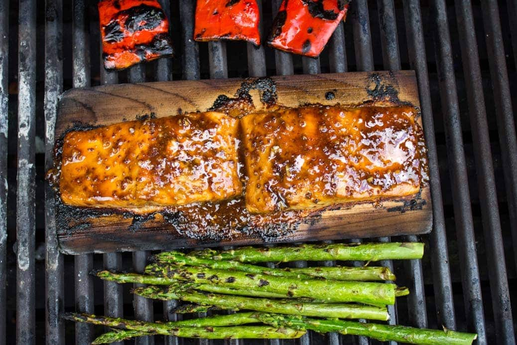 Canadian Maple Planked Salmon. Pure maple syrup, grainy mustard, balsamic vinegar, butter and garlic make a luscious glaze for this smokey moist salmon.