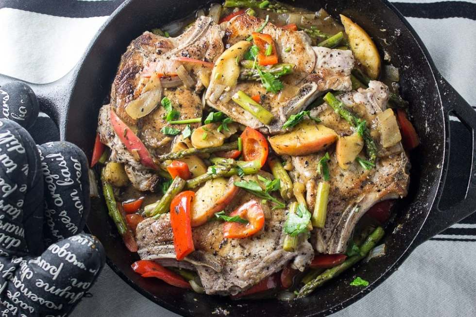 Skillet Pork Chop Dinner. Tender pork chops with apples, peppers, asparagus and thyme made in one skillet