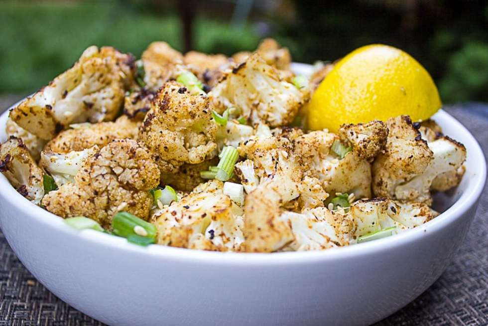Grilled Spiced Cauliflower seasoned with cumin, coriander, smoked paprika and garlic.
