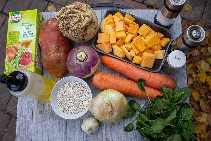 carrots, butternut squash, celeriac, turnip, sweet potato, onion, garlic, spinach, oil, broth, thyme, salt, pepper