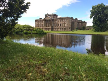 Lyme Park's later west façade with a typical mirror pond.
