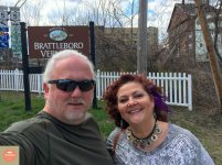 """Photo: Robert and Debra at the """"Welcome to Brattleboro"""" sign"""