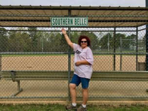 """Photo: Debra in front of a """"southern belle"""" sign at Nashville City Park"""