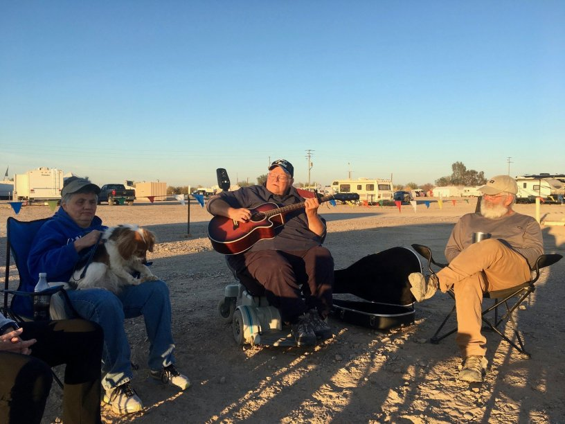 Photo: Gathered around the campfire with a guitar
