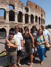 The family with view of the Colosseum