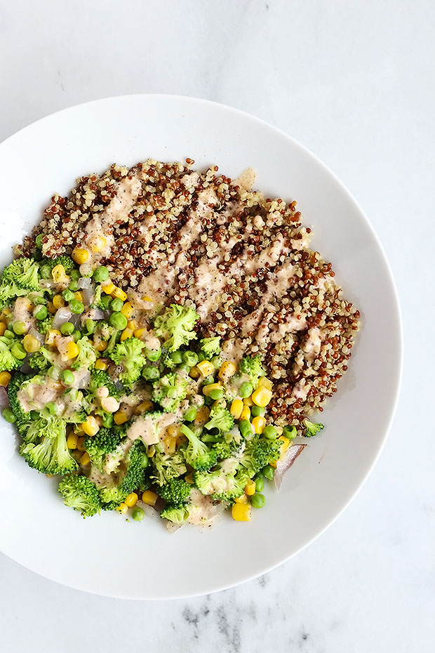 This Superfood Quinoa Bowl 2.0 takes only 30 minutes to prepare, and is full of flavor with a chili flavored dressing! Vegan and Gluten Free. / TwoRaspberries.com