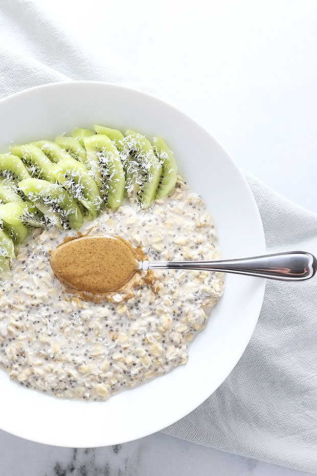 Coconut, kiwi, and almond butter come together perfectly in these Tropical Kiwi Coconut Almond Overnight Oats! Plus a VIDEO. Vegan and Gluten Free. / TwoRaspberries.com