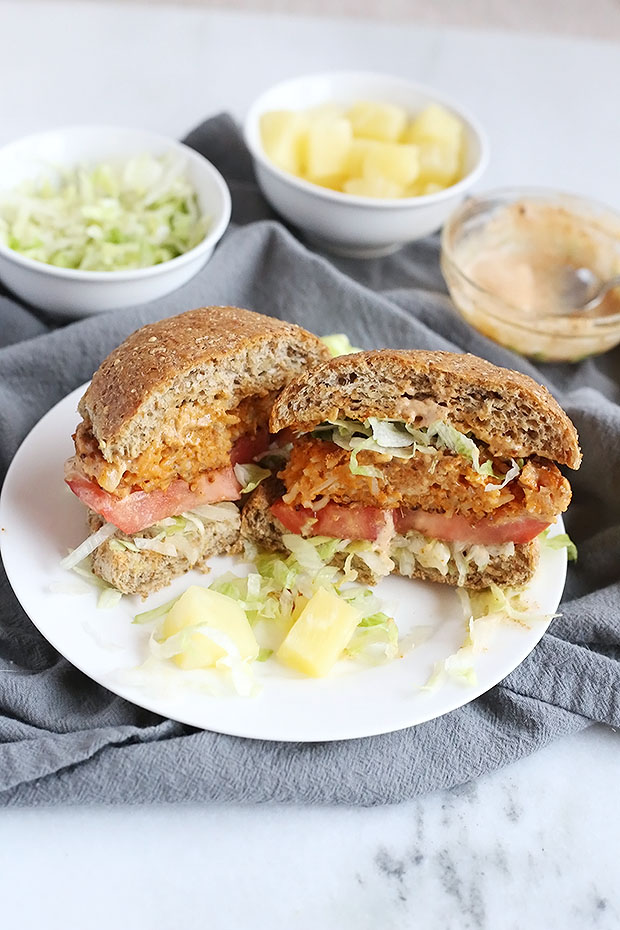 These Vegan Chili Pineapple Sweet Potato Burgers are FULL of flavor! sweet pineapple and spicy chili make an amazing combo. A chili flavored spread pairs perfectly with these burgers! Vegan and Gluten Free Option. / TwoRaspberries.com