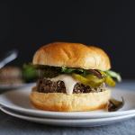 These 5 Ingredient Garlic Onion Black Bean Burgers are SO easy to make, paired with a tahini lime sauce, healthy, VEGAN and GF! | TwoRaspberries.com