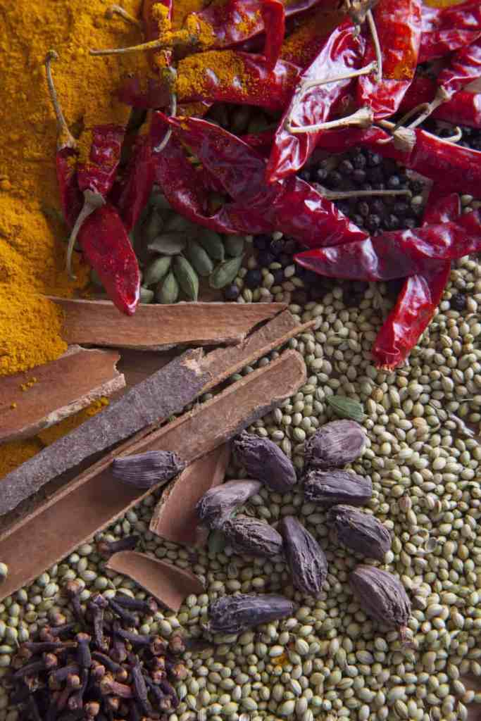 Raw ingredients for homemade garam masala recipe with various spices showing