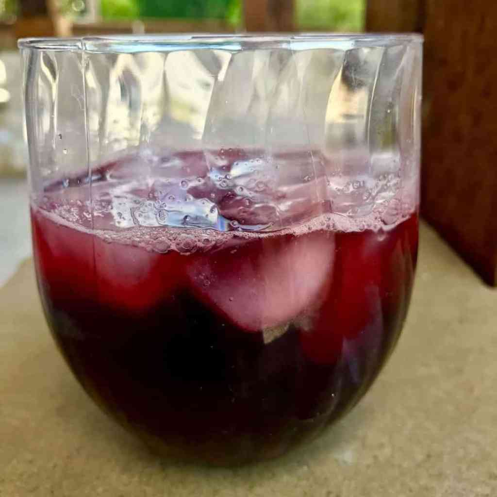 Pressure cooker agua de jamaica hibiscus tea two sleevers it makes a very deep red drink like the one above i had to take it out in the sunshine so you could see any pink in it as the first picture izmirmasajfo