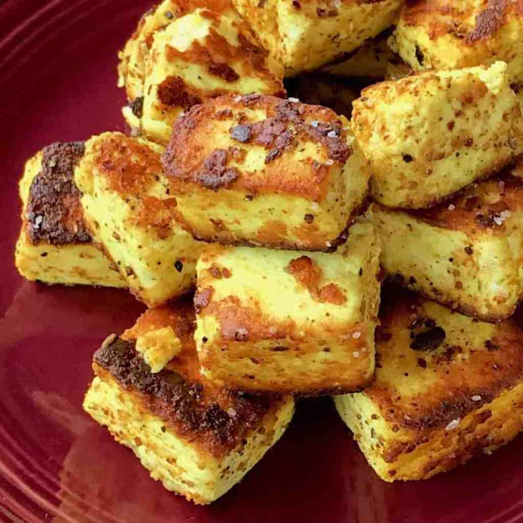 Low Carb Quick Paneer Tikka. Spiced paneer, panfried quickly in ghee for a savory, Indian snack. Find a recipe for homemade paneer as well at www.twosleevers.com