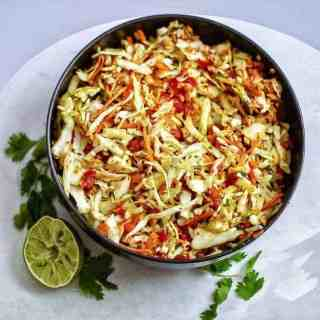 Indian style raw cabbage peanut slaw makes a great accompaniment to any meal. One of my favorite summer salads!| twosleevers