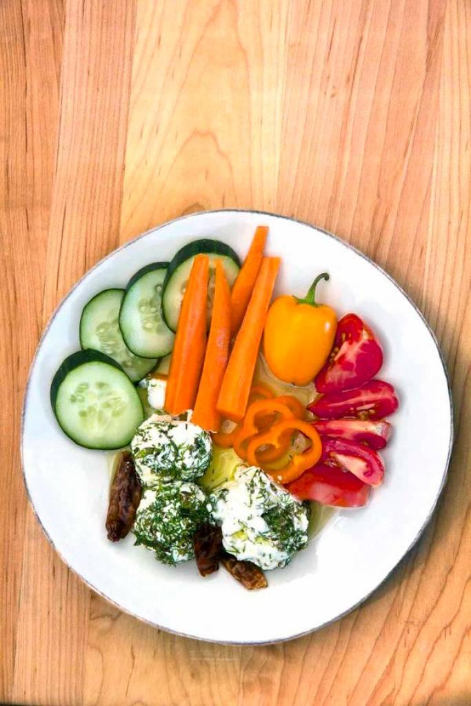 Labneh yogurt dill balls overhead with vegetables