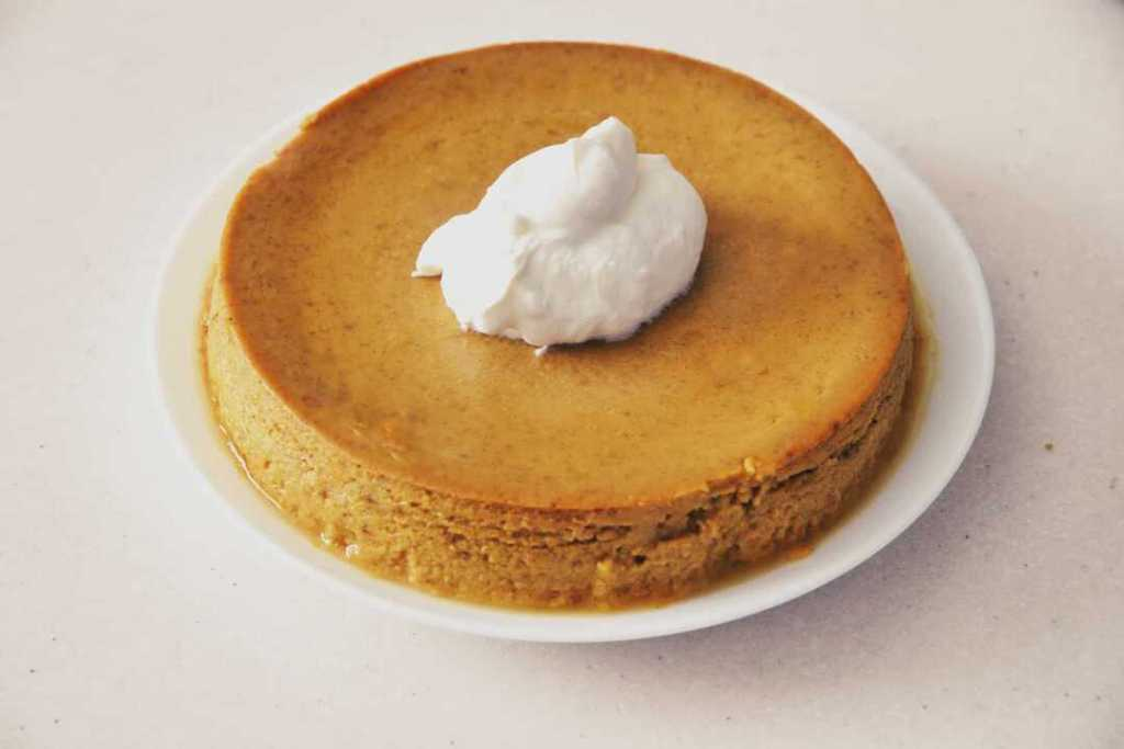 Overhead shot of crustless pumpkin pie. Perfect, low carb keto crustless pumpkin pie pudding makes a lovely low carb pumpkin dessert in your Instant Pot or Pressure cooker. This is an easy dump and go dessert.