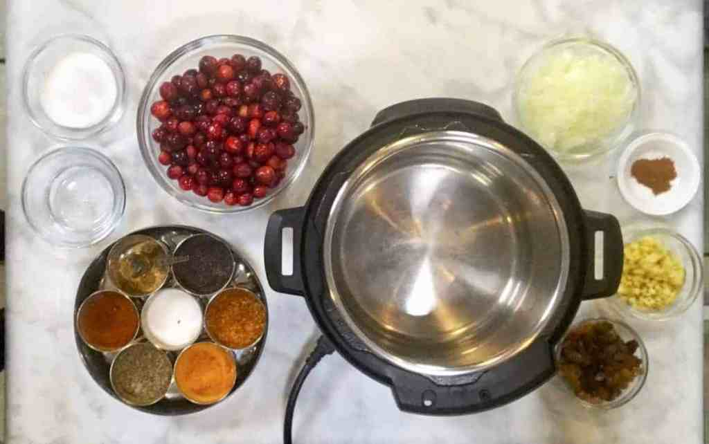 Fixings for Pressure Cooker Cranberry Chutney. This spicy, sweet, and tangy Pressure Cooker Cranberry Chutney will wow your guests and make a wonderful addition to your cheese tray, besides providing an exotic flavor at your dinner table.
