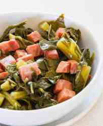 Southern Style Collard Greens and Ham. No need to miss your beans and greens with this low carb ham and greens recipe! Simple dump and cook recipe for your Instant Pot or Pressure cooker makes a tasty side dish in under 30 minutes.